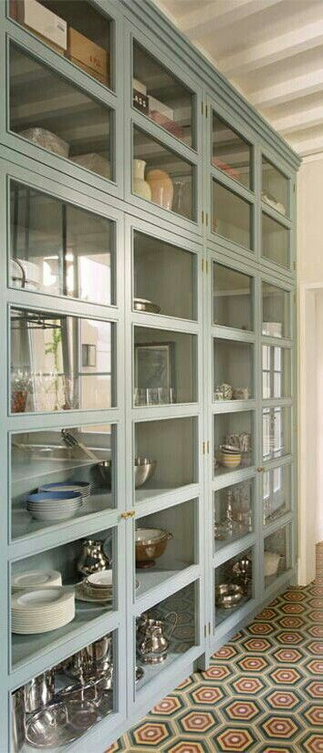 fantastic wall size glass front cabinets