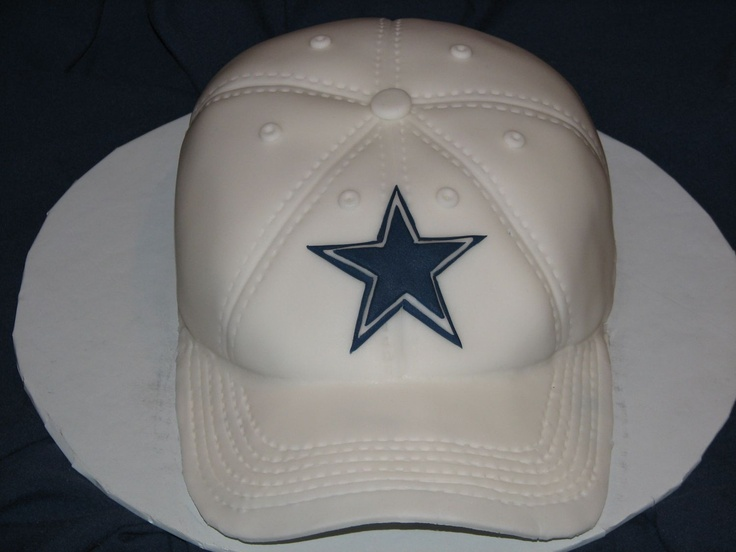 Dallas Cowboys Hat - I did this cake for my husbands birthday (he is a fan of he Cowboys).  This was my first attempt at a 3D baseball hat and was  quite the learning experience for me.  The entire cake is done in fondant.
