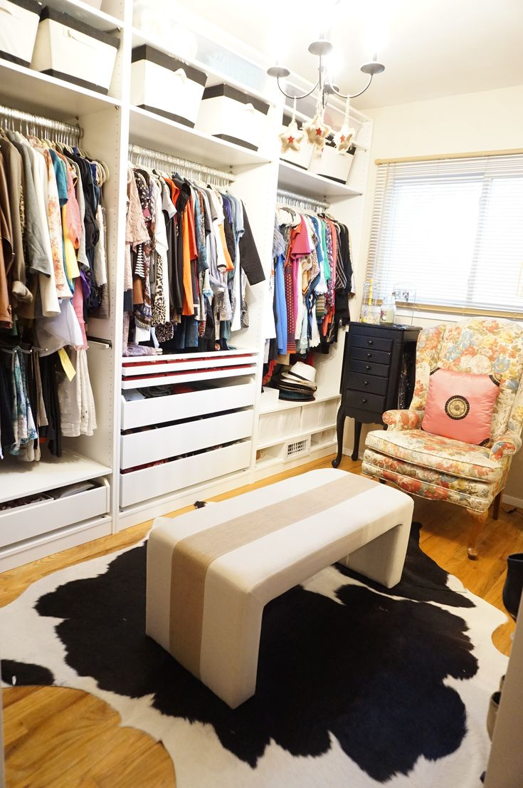 turning apartment bedroom into a closet features strong iron hanging rail for dress and standing wooden frame mirror ideas