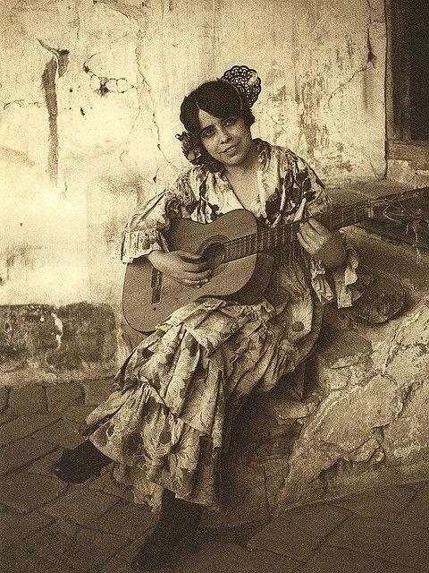 Spanish Gypsy woman playing the guitar, photo by Kurt Hielscher, 1914 - 1919.*