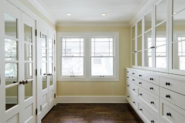 built-in drawers with storage space on top for opposite bed? Would make handles more modern / less visible and would use wall paper or something to go with wall colour, instead of mirrors