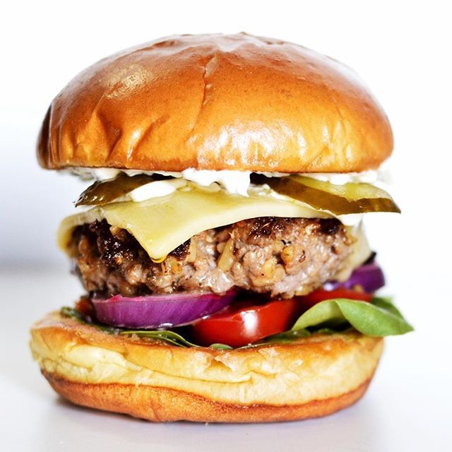 Lamb & Bulgar Burger With  Tzatziki, Chili Sauce And Quick-pickled Red Onions