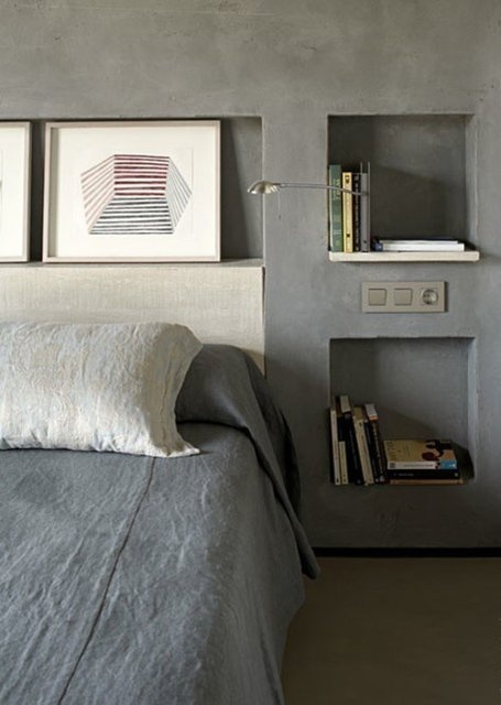 Concrete walls in the bedroom.