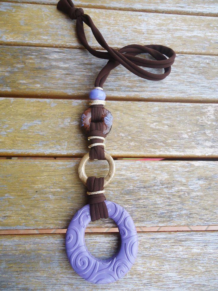 Unique and original necklace.... Light purple, brown and bronze...