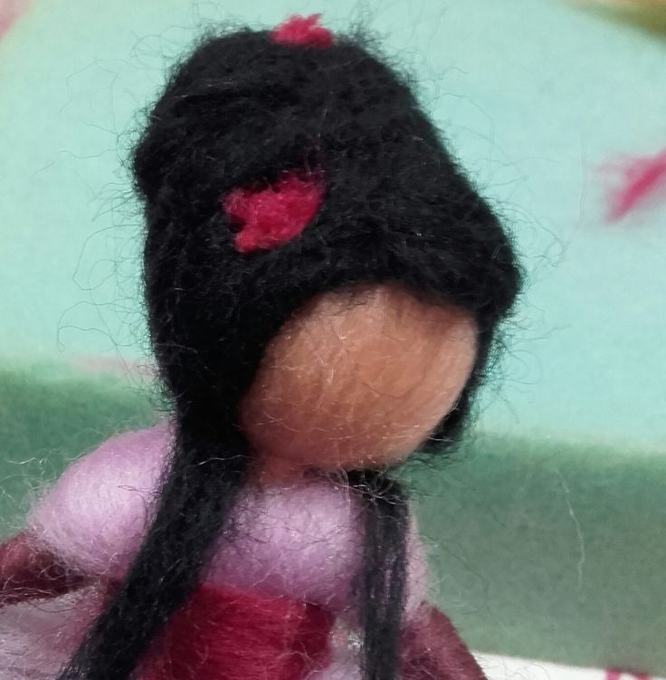 Detalle hada de lana cardada