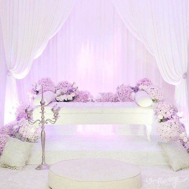 Simple and sweet solemnization dais by @flair_design.