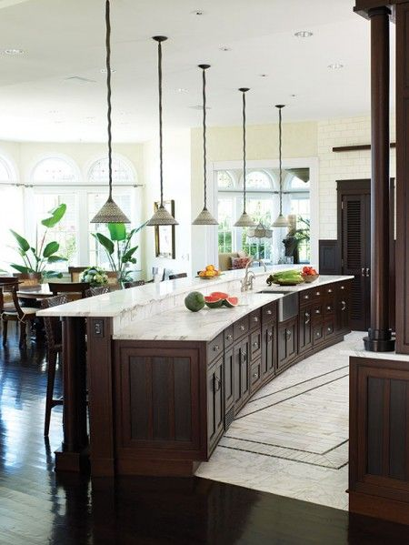 Curved cabinetry, kitchen pendant lighting...love!