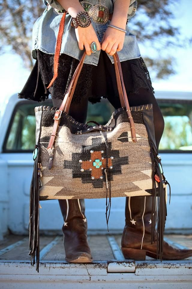 The Brissa LOVE IT !!! Navajo Handbags made from blankets / rugs, vintage horse tack, and deer, elk or cowhide leathers. embellish the bags with vintage trade beads, turquoise, coral, nickel silver/German silver Concho buttons, nickel silver spots/studs, and deer antler tips.