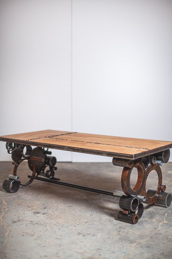 I really really love the legs **  steel and wood, reclaimed coffee table. $1,100.00, via Etsy.: