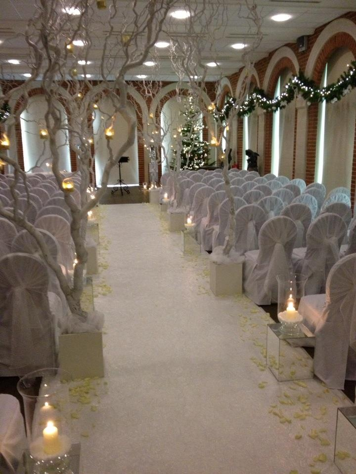 Winter Wonderland at Great Fosters Hotel. Magical setting with white willow tree linned aisle.