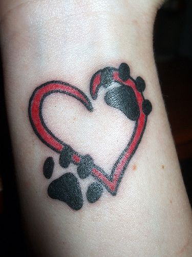 paw prints and heart tattoo. Not big into the red and black