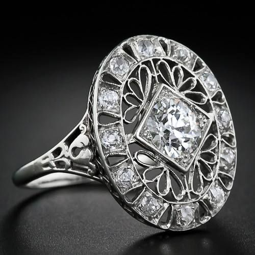 An Early Twentieth Century Sumptuous And Sizable Dinner Ring Highlighting A Bright Beautiful Carat European Cut Diamond The Sparkling Center Stone Is
