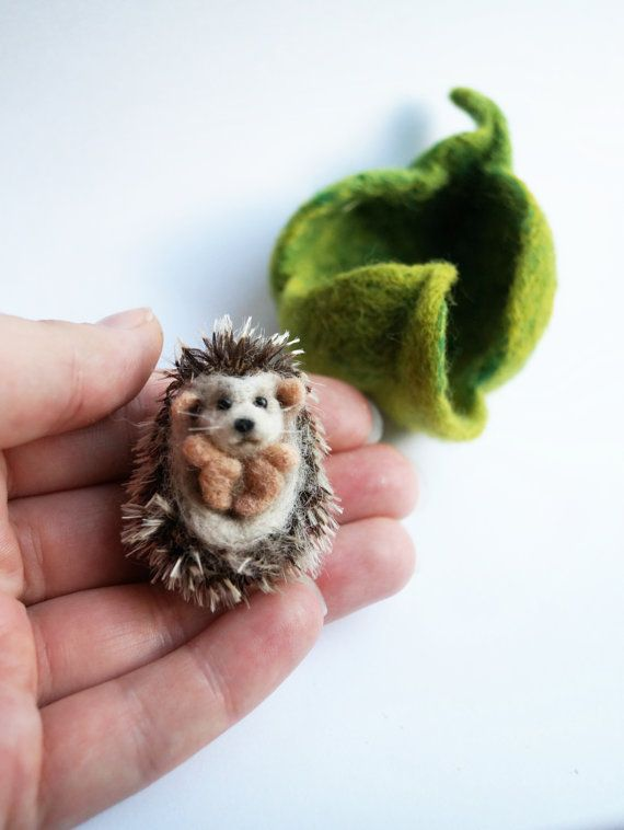 Needle felted hedgehog in a leaf