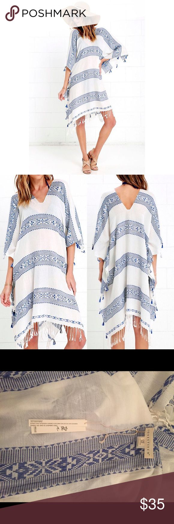"""BLUE AND IVORY KAFTAN COVER-UP NWT NWT NEVER WORN▫️Blue woven stripes, in a southwestern design, decorate a flowy kaftan cover-up with tassel and fringe accents along the hems. Fringe measures 3"""" at bottom. 50% Viscose, 50% Polyester. Fit: This garment fits true to size. Length: Knee to mid-calf length. Size one size measures 37"""" from shoulder to hem. Bust: Great for any cup size. Waist: Not Fitted - comfortable room throughout midsection. Hip: Not Fitted - room for hips. Lulu's Swim…"""