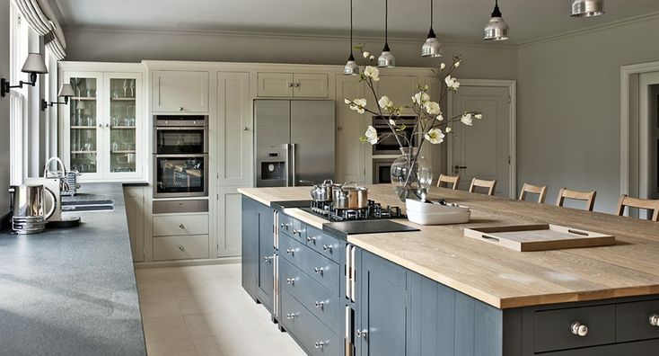 grey, cream, wood large scale kitchen design. Massive Island bench!