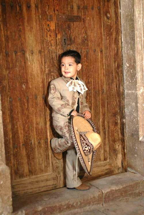 There is a part of the book in which Luz sees a picture of a young Eddo dressed in a mariachi traje, jsut like this young boy. HC