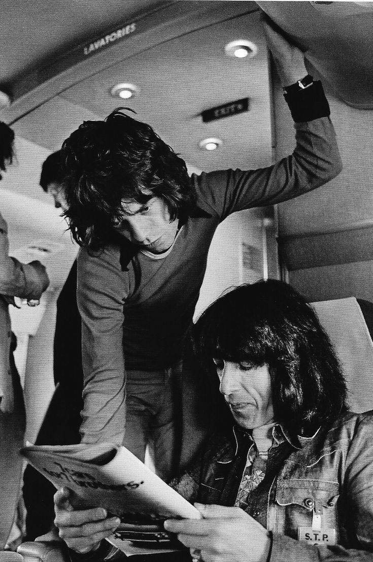 *m. Mick Jagger and Bill Wyman in their private jet, 1972. | rock n roll lifestyle | fly | travel | on tour | black white | vintage | 1970s | hot lips | the rolling stones | iconic |