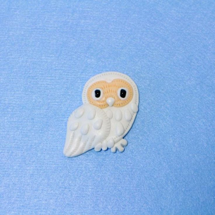 The Owl brooch from notive how feathers were made. Tg