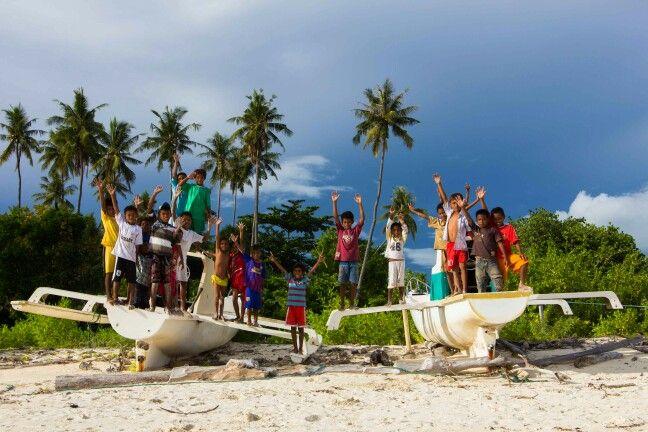 Crowded of allitel kids on remote island of raja ampat