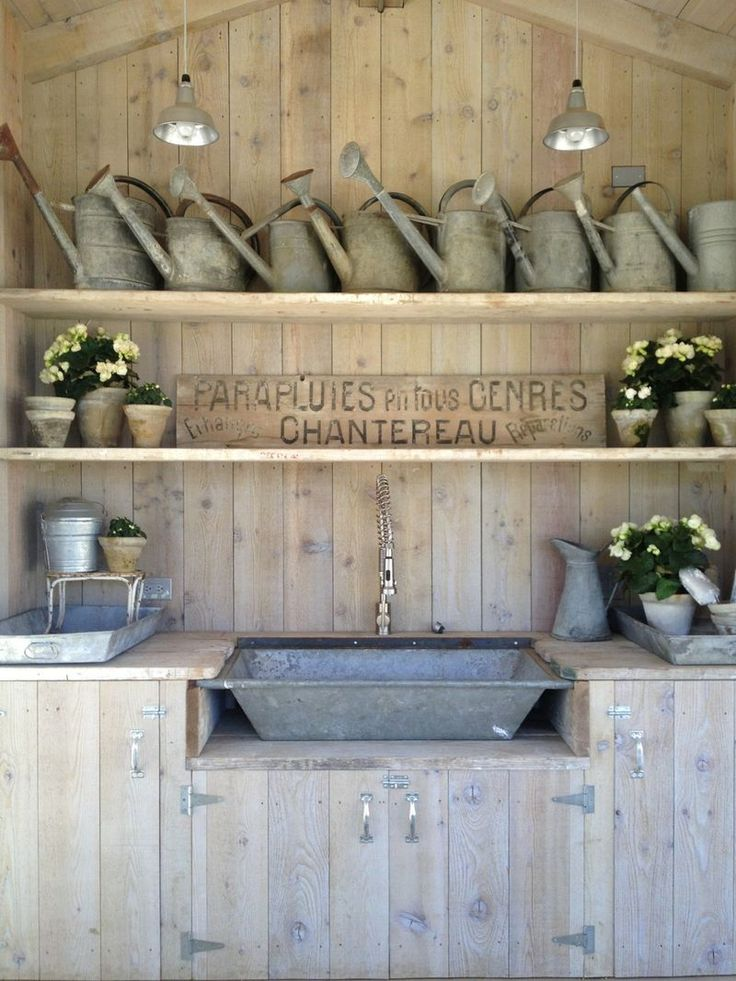 patina farm....I have a collection of similar watering cans and also want to put lights just like these in my potting shed