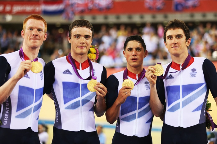 (L-R) Edward Clancy, Steven Burke, Peter Kennaugh and Geraint Thomas of Great Britain celebrate with their gold medals during the medal ceremony for the Men's Team Pursuit Track Cycling final on Day 7 of the London 2012 Olympic Games at Velodrome on August 3, 2012 in London, England.