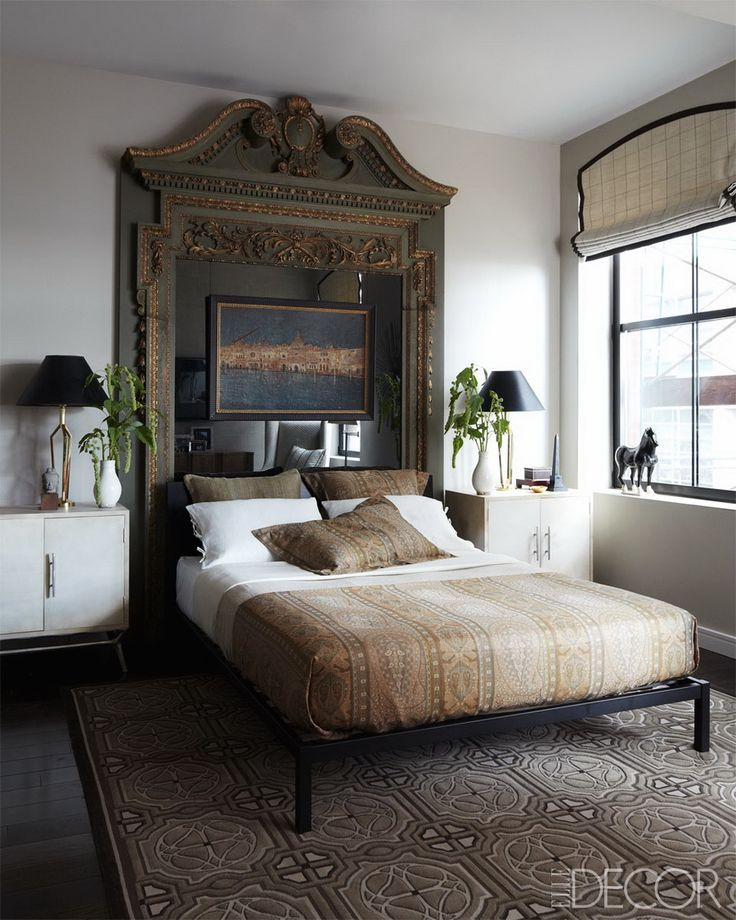 antique door frame turned headboard paired with