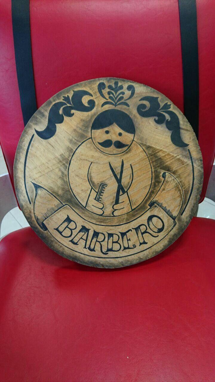 Sobre madera y envejecido con betún de judea.  Cartel para peluquería y barberia en Buenos Aires.