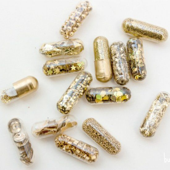 Create a Glamours Golden Valentine with gold glitter pills and a free printable.