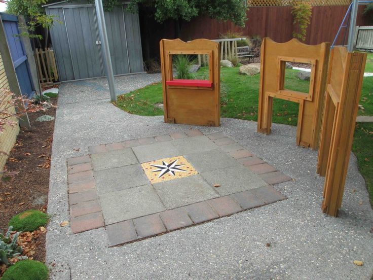 """A """"house"""" concept in an under two playground. Allowing for free play, exploration and the use of imagination."""