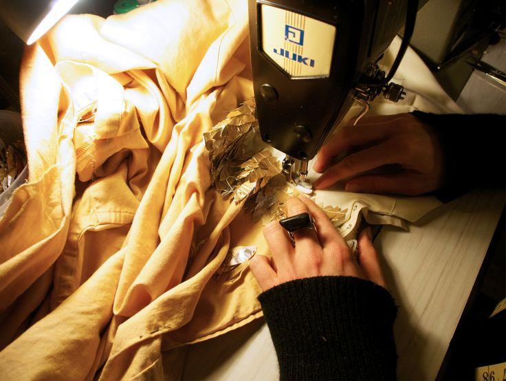 Stitching the alluminium petals onto the recycled shirt dress. www.mucke.com.au