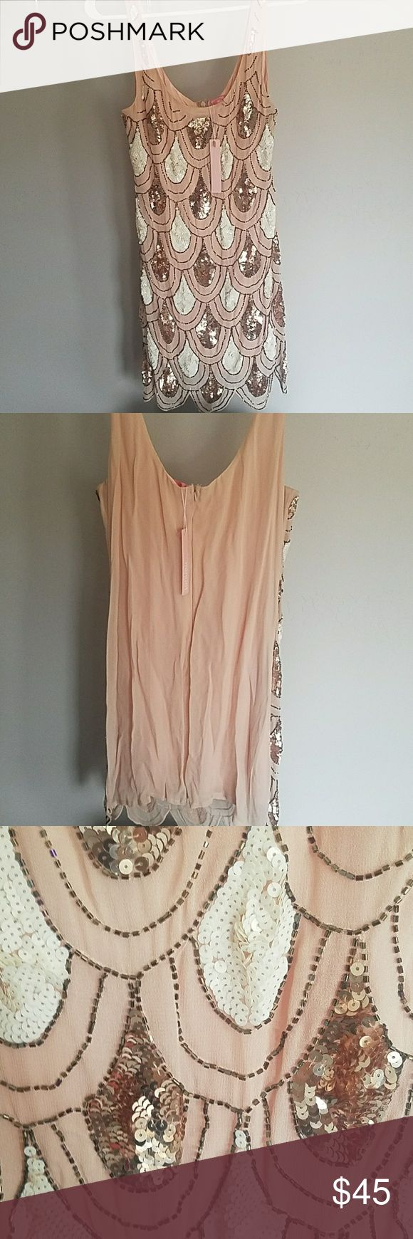 Pink peach sparkly dress by minuet Pink Peach sparkly dress with white and gold sequence never been worn.. Minuet Petite Dresses Midi