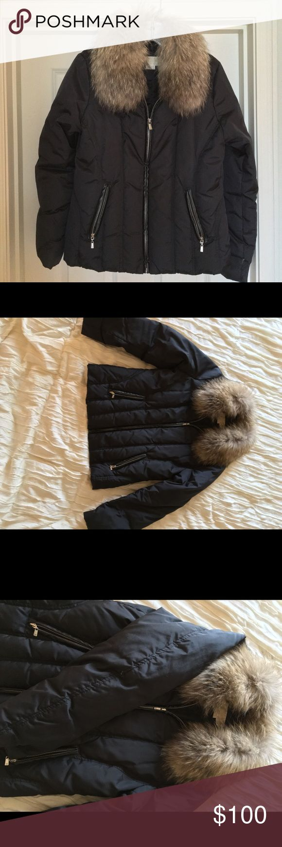 Michael Kors Raccoon fur collar puffer coat This black puffer coat will keep you warm and stylish this winter! The detachable collar is real raccoon fur, and is in excellent condition. The zippers all work. It's got a nice silhouette when worn, and is not too bulky. Michael Kors Jackets & Coats