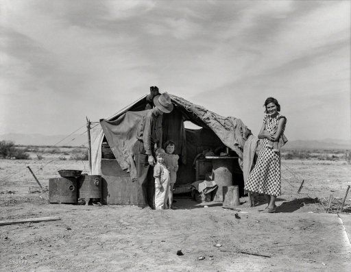 "Spring 1937. ""This family without food and work about to be returned to Oklahoma by the Relief Administration. They have lost a baby as a result of exposure during the winter. Had to sell their tent and car to buy food. Neideffer Camp, Holtville, Imperial Valley, California."" Photo by Dorothea Lange for the Resettlement Administration. View full size."