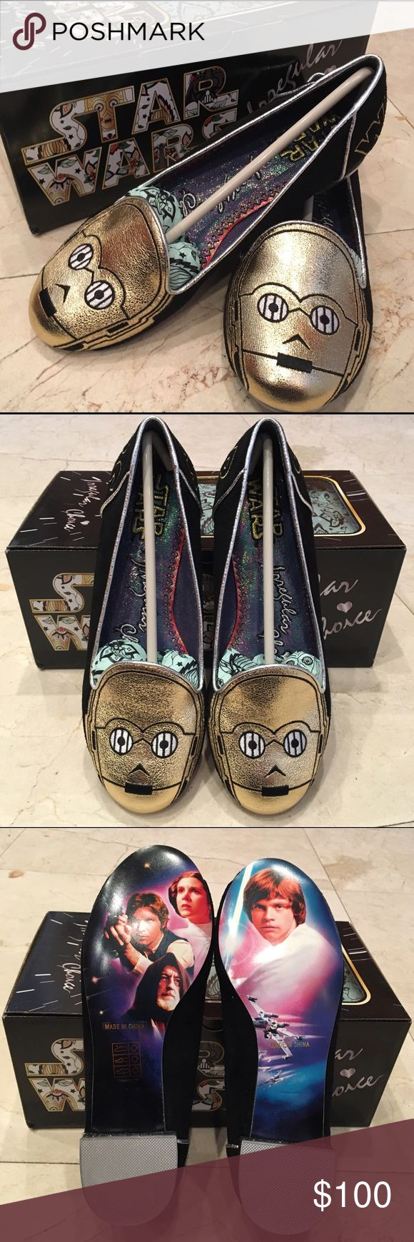 "Irregular Choice Star Wars Flats C-3PO Flats - Limited Edition •Officially-licensed Star Wars merchandise  •C-3PO's head in gold applique and black thread  on both toes •""Star"" embroidered in gold on one heel and the word ""Wars"" on the other •Silver edge dressing with glitter on the heel itself •Iridescent inner •Full-color classic images on the sole They paid attention to all the details - even the tissue paper is Star-Wars-inspired Materials: PU & black faux-suede fabric Heel height: 0.7""…"