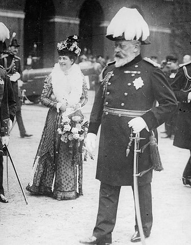 a candid photo of King Edward VII and Queen Alexandra (1908).  He and his mother Queen Victoria were the first to be photographed with the new Camera invention.