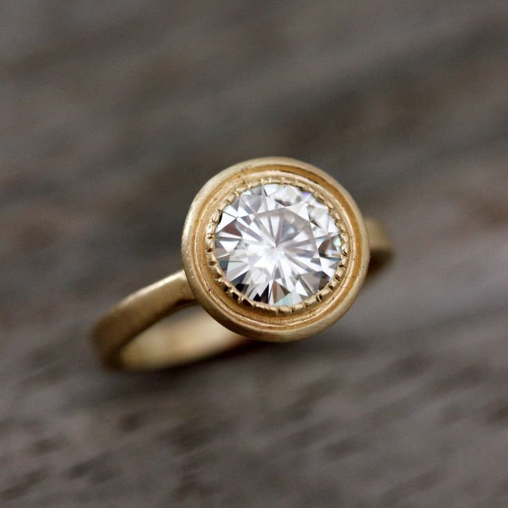 Moissanite and 14k Yellow Gold Engagement Ring, Matte Gold and Textured Bezel READY To SHIP SIZE 7. $2,498.00, via Etsy.