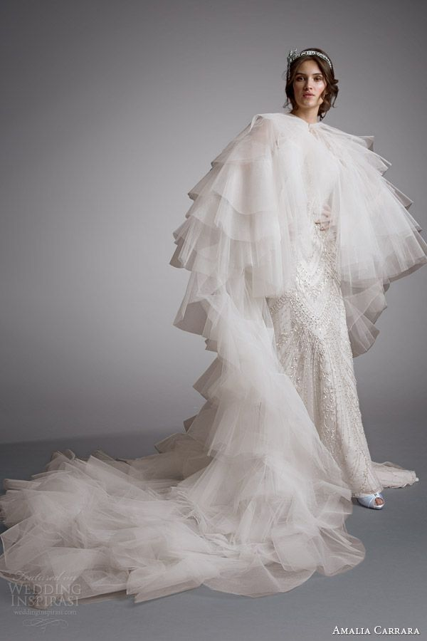 This over-the-top wedding cape is perfect for a lac e themed wedding.