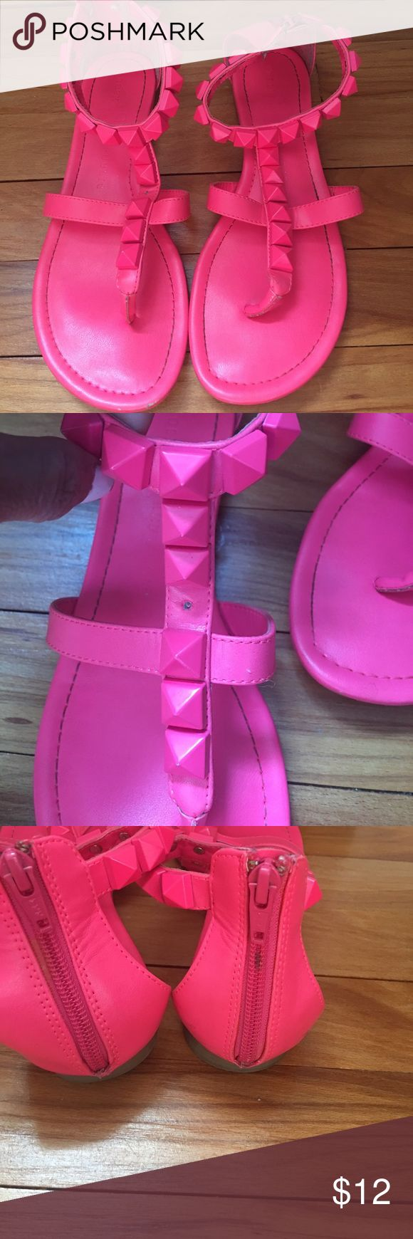 Neon pink studded sandal These are cute neon pink rock and republic studded sandal. See pics. There is one stud missing on the front. Always intended on taking one off the side in the back and putting it there but just didn't ! Rock & Republic Shoes Sandals
