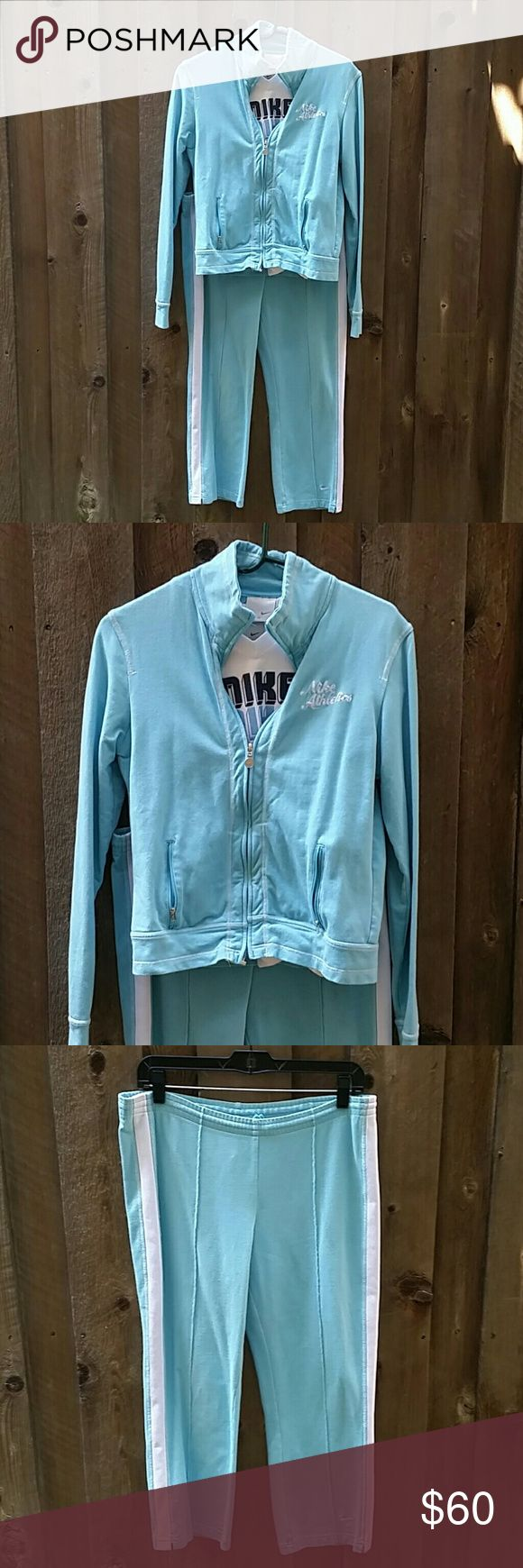 "Nike Light Blue Jogging Suit Size M Nike Light Blue Jogging Suit Size M with White Nike Shirt Size L.  The pants have an elastic waist and come right above my ankle (I sm 5'4"").  Jacket had Nike Athletics written on it. There is a faint stain on the shirt as noted in last pic. Used in good condition.  Will sell shirt separately if you would like just the shirt. Let me know and I'll list a separate ad. No trades / No PayPal.  Smoke and Pet free home.  Please ask questions.  Like what you see…"