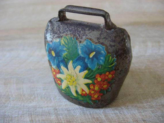 Antique cowbell, dinner bell. Excellent sound. Swiss 1960s iron goats bell, floral decoupage. Quality craftsmanship. Lovely patina to metal. @PumpjackPiddlewick on Etsy