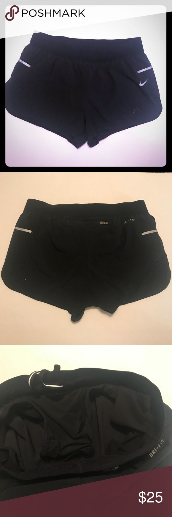 Nike Running Shorts Black running shorts with lining, small inner pocket and zip back pocket. They have reflective strips on side and perforated details. Never worn. Nike Shorts