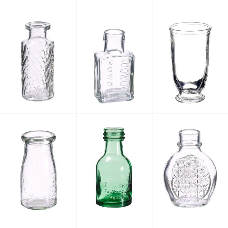 A selection of glass bud vases perfect for a vintage-look wedding, dinner tablescape, or accent flowers for an event.