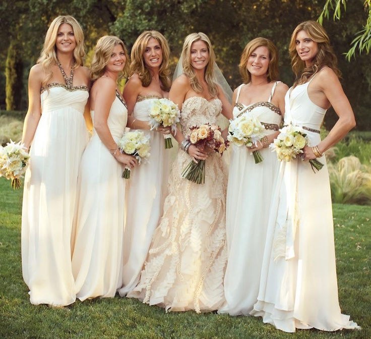 These custom-made cream bridesmaid dresses have us drooling. Don't they make the bride's blush Monique Lhuillier gown look even more sensational?