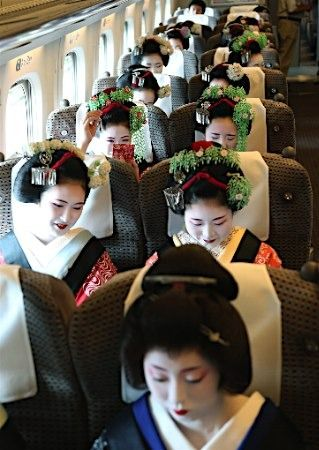 Geisha on a train...
