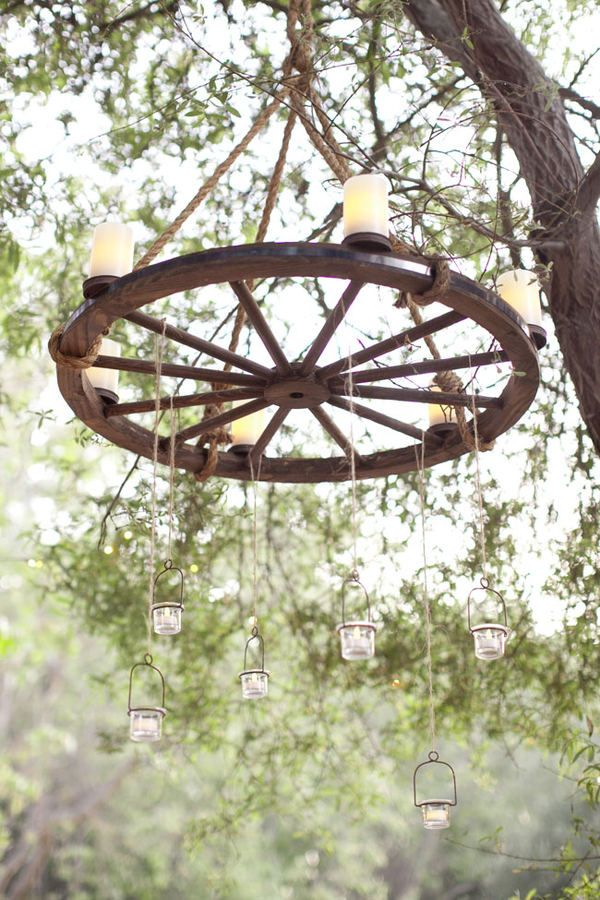 25 best ideas about wheel chandelier on pinterest wagon for Rustic outdoor chandelier