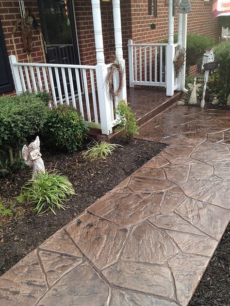 I like this stamped concrete overlay. This would be a great look for the front walk. I wonder how it would hold up to MN winters.