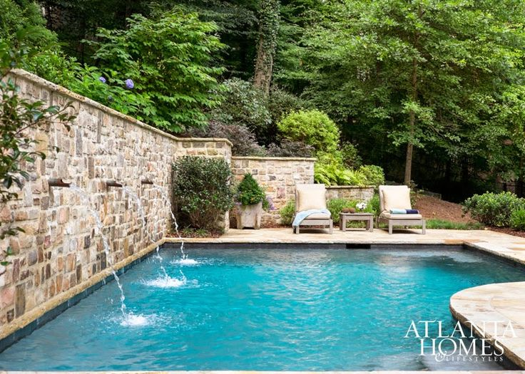 Retaining wall of stone with water feature.  Beautiful swimming pool.  LIZ WILIAMS ~ DESIGN IN BUCKHEAD
