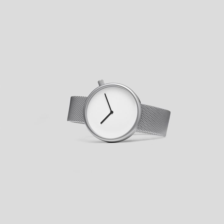 MATTE STEEL ON A GERMAN-MADE, MILANESE MESH FROM VOLLMER.  Following the slightly asymmetric Pebble and the clean and contemporary Facette, the circular, minimalist Ore watch reduces timekeeping to its pure essence.