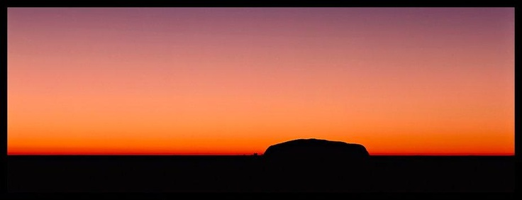 Ayers rock and dawn sky. Uluru-Kata Tjuta National Park, Northern Territories, Australia (Panoramic).