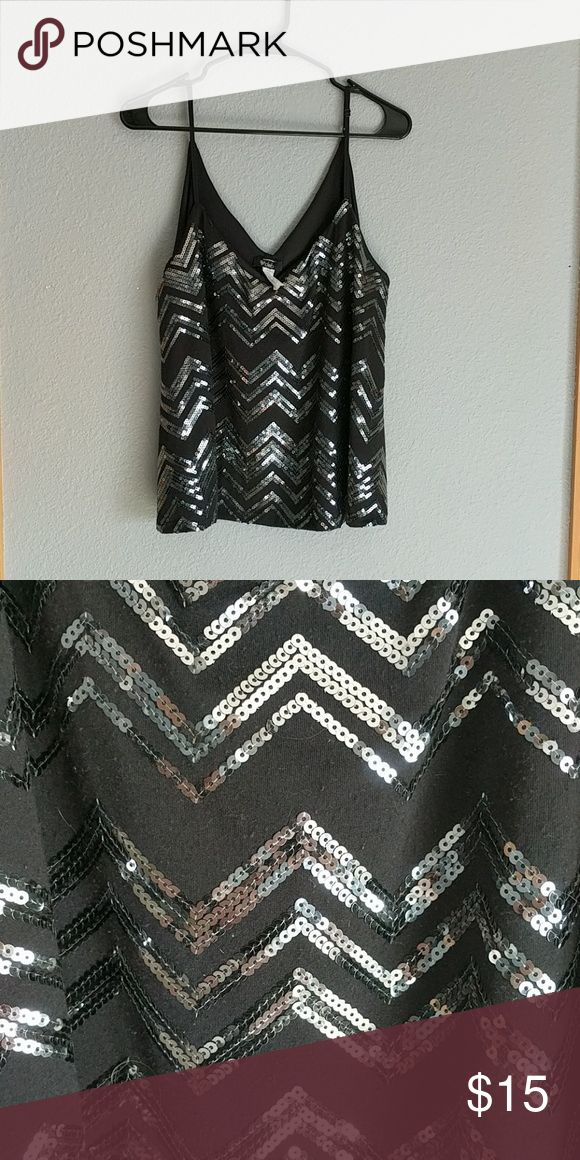 Black and silver crop top Black crop top with silver sequins in a Chevron pattern. Spaghetti straps and has inner lining Deb Tops Crop Tops